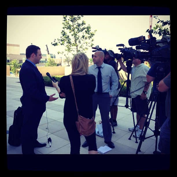 Adam talking to media during an important trial