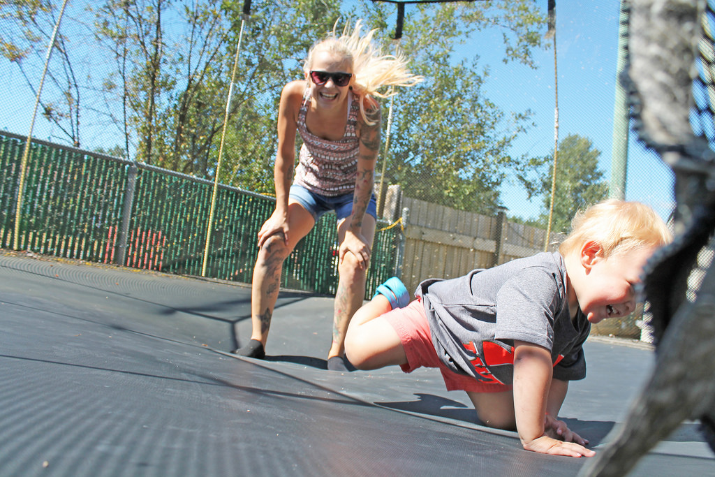 Mother and son on trampoline