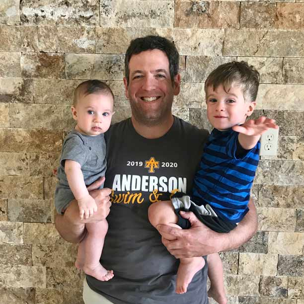 Adam with his sons, Lochlan and Clayton
